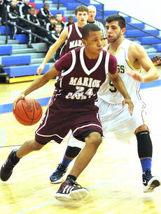 """<div class=""""source"""">Photo by Jessica Veatch</div><div class=""""image-desc"""">Sophomore Latrelle Irvin drives to the basket during the first round game.</div><div class=""""buy-pic""""><a href=""""/photo_select/17073"""">Buy this photo</a></div>"""