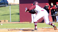 "<div class=""source"">Gerard Flanagan</div><div class=""image-desc"">Davis Rafferty lays down a bunt in Marion County's 5-2 win over Taylor County on April 9 at Dave Hourigan Field. </div><div class=""buy-pic""><a href=""/photo_select/60666"">Buy this photo</a></div>"