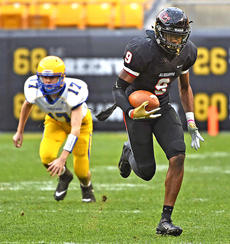 "<div class=""source""></div><div class=""image-desc"">Aliquippa's M.J. Devonshire scored a touchdown against Derry in the Pennsylvania Class 3A championship game last season  at Heinz Field. (Christopher Horner 