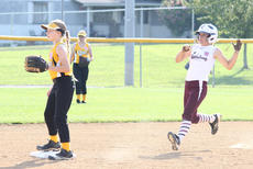 "<div class=""source"">Nick Schrager</div><div class=""image-desc"">Cassidy Logsdon reaches second base easily in Marion County's win over Clay County. </div><div class=""buy-pic""><a href=""/photo_select/28360"">Buy this photo</a></div>"