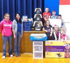 """<div class=""""source"""">Photo submitted</div><div class=""""image-desc"""">Brooke Benningfield's class raised $520 for the Marion County Animal Shelter. They used part of the money and did the shopping. Items purchased were dog crates, cat carriers, cleaning supplies, organizers and enough toys for all of the shelter dogs and cats to be happy for a long time. Kentucky Cooperage donated $500 for two new, much needed dog kennels. They were used at the Farm and Garden Show and are being used for more space for shelter animals. Lee Morgeson's class at Glasscock donated over 700 pounds of old newspapers. Donations are always appreciated at the Marion County Animal Shelter.</div><div class=""""buy-pic""""></div>"""