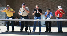 "<div class=""source"">Stephen Lega</div><div class=""image-desc"">Colley, far right, was also competed  in the Slop the Hogs competition during Ham Days. He is pictured in the finals of the 2010 ham biscuit-eating competition.</div><div class=""buy-pic""><a href=""/photo_select/25961"">Buy this photo</a></div>"