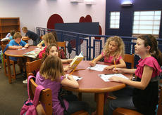 "<div class=""source"">Stephen Lega</div><div class=""image-desc"">Menla Marlowe's second-grade students squeezed into a corner of the St. Charles media center.</div><div class=""buy-pic""><a href=""/photo_select/11592"">Buy this photo</a></div>"