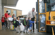 "<div class=""source"">Stephen Lega</div><div class=""image-desc"">St. Charles Principal John Brady oversees the elementary students as they board the buses to return to West Marion.</div><div class=""buy-pic""><a href=""/photo_select/11596"">Buy this photo</a></div>"