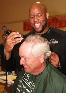 "<div class=""source""></div><div class=""image-desc"">Honorary barber Anthony Epps starts the shaving by shearing Bob Abell of team Bobarazzis. Abell is the grandfather of Avery Leachman, this year's ambassador child.</div><div class=""buy-pic""><a href=""/photo_select/26289"">Buy this photo</a></div>"