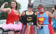 """<div class=""""source"""">Stephen Lega</div><div class=""""image-desc"""">The Back Tutu School run had (from left) Savannah Browning, Stephanie Keeling and Sharon Mosz feeling heroic.</div><div class=""""buy-pic""""><a href=""""/photo_select/28726"""">Buy this photo</a></div>"""
