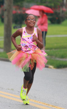 """<div class=""""source"""">Stephen Lega</div><div class=""""image-desc"""">Imani Biggers, who has participated in Girls on the Run, was among the runners Saturday morning.</div><div class=""""buy-pic""""><a href=""""/photo_select/28730"""">Buy this photo</a></div>"""