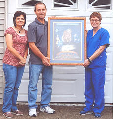 "<div class=""source""></div><div class=""image-desc"">A drawing was held on Sept. 9 to help support Alzheimer's Association. Kevin and Dora Bickett of Loretto donated a framed U.K. print. Pictured are, from left, Dora and Kevin Bickett and Cindy Burgos accepting the framed print for winner Chris Spalding of Loretto.  </div><div class=""buy-pic""></div>"