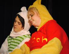 """<div class=""""source""""></div><div class=""""image-desc"""">Winnie-the-Pooh, played by Emma Spalding, and Piglet, played by Jacob McCrosky, lean on each other as they rest their eyes. </div><div class=""""buy-pic""""></div>"""