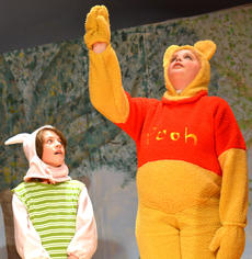 """<div class=""""source""""></div><div class=""""image-desc"""">Winnie-the-Pooh, played by Anna Spalding, tries to figure out how she can get the honey out of the tree as Piglet, played by Jacob McCrosky, patiently listens.  </div><div class=""""buy-pic""""></div>"""