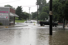 "<div class=""source""></div><div class=""image-desc"">Water covered a good portion of Proctor Knott Avenue north of Main Street after the downpour Monday evening.</div><div class=""buy-pic""><a href=""/photo_select/27998"">Buy this photo</a></div>"