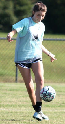 """<div class=""""source"""">Gerard Flanagan</div><div class=""""image-desc"""">Ava Drury handles the ball during girls soccer practice on July 25 at the high school.</div><div class=""""buy-pic""""></div>"""
