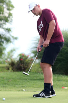 """<div class=""""source"""">Gerard Flanagan</div><div class=""""image-desc"""">Allen May putts the ball at during golf practice at the Lebanon Country Club on July 18. </div><div class=""""buy-pic""""><a href=""""/photo_select/67620"""">Buy this photo</a></div>"""