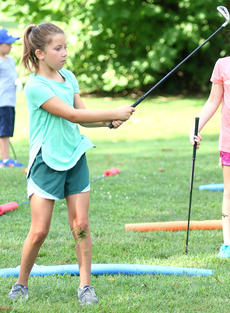 """<div class=""""source"""">Gerard Flanagan</div><div class=""""image-desc"""">Olivia Gribbins takes a swing at the ball at junior golf practice on July 18 at the Lebanon Country Club. </div><div class=""""buy-pic""""><a href=""""/photo_select/67614"""">Buy this photo</a></div>"""