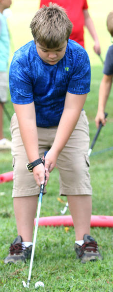 """<div class=""""source"""">Gerard Flanagan</div><div class=""""image-desc"""">Levi Bowen prepares to hit the golf ball at junior golf practice on July 18 at the Lebanon Country Club. </div><div class=""""buy-pic""""><a href=""""/photo_select/67615"""">Buy this photo</a></div>"""