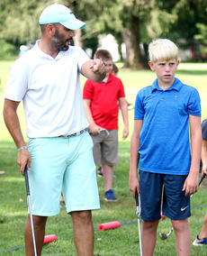 """<div class=""""source"""">Gerard Flanagan</div><div class=""""image-desc"""">Freddie Montgomery (right) receives instruction from Coach Reed (left). </div><div class=""""buy-pic""""><a href=""""/photo_select/67613"""">Buy this photo</a></div>"""