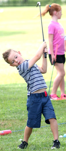 """<div class=""""source"""">Gerard Flanagan</div><div class=""""image-desc"""">Carter Oliver takes a big swing at junior golf practice on July 18 at the Lebanon Country Club. </div><div class=""""buy-pic""""><a href=""""/photo_select/67612"""">Buy this photo</a></div>"""