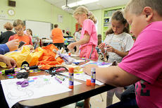 """<div class=""""source"""">Photos submitted</div><div class=""""image-desc"""">Students worked on arts and crafts projects focusing on Appalachian culture.</div><div class=""""buy-pic""""></div>"""