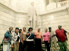"<div class=""source"">Photo submitted</div><div class=""image-desc"">Local residents recently traveled to the Kentucky Capitol in support of removing the Jefferson Davis statue from Capitol grounds. Pictured, from left, are Marianne Osborne, Rose Graves, Myrtle Lee Folmar, Dorothy Ann Williams, Katie Gunn, Rev. Tommy Calhoun, Geneva Bell, John Body, and Charles Bell. </div><div class=""buy-pic""></div>"