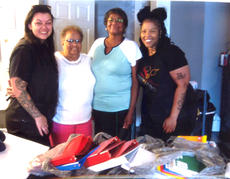 "<div class=""source"">Photo submitted</div><div class=""image-desc"">Lavonne Downs and Ann Young, members of St. Peter Claver Ladies Auxiliary, Saint Augustine Ct. 373, presented bags of school supplies to the backpack event hosted by Ronisha Gowdy and Brittianey Sapp at their hair salon, Twisted Shears. This has been an on-going event for the two of them for the past three years. </div><div class=""buy-pic""></div>"
