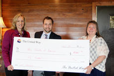 """<div class=""""source"""">Photo submitted</div><div class=""""image-desc"""">United Way board members Jamie Sizemore and Sandra Cunningham present a $500 check to Boy Scouts Regional Director Stephen Whitehead on April 29. </div><div class=""""buy-pic""""></div>"""