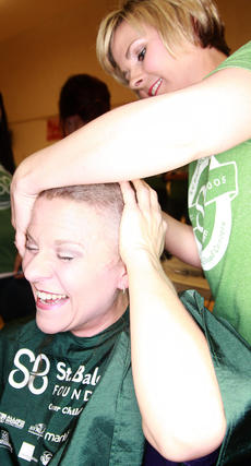 "<div class=""source"">Stephen Lega</div><div class=""image-desc"">Stevie Lowery rubs her head for the first time with her new haircut.</div><div class=""buy-pic""><a href=""/photo_select/33071"">Buy this photo</a></div>"