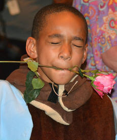 """<div class=""""source""""></div><div class=""""image-desc"""">Zakias Newby poses for a photo with a flower in his mouth from one of his biggest fans.</div><div class=""""buy-pic""""></div>"""