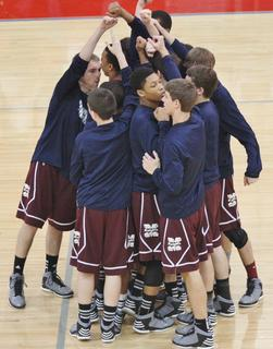 The Knights huddle up prior to their game against Adair County in the 2013 20th district tournament game.