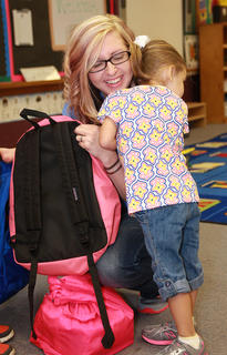 Every year brings triumphs and tragedies, and many of those moments were captured by photos. Here is a selection of some of the best and most memorable images of 2013. The first day of school can be exciting and a little scary as St. Augustine preschooler Whitney Elder showed while clinging to her mother, Kelly Elder.