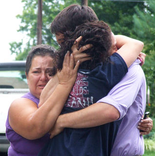 Unfortunately, Marion County had a number of tragic incidents again this year. At a house fire in August, Coury Osbourne embraced her husband, Jesse, when he arrived at the scene of the fire at 475 N. Spalding Avenue. Jesse's mother, Gale, embraced both of them.