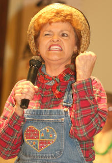 "The St. Joe community hosted its own version of the variety show ""Hee Haw"" on Dec. 8. The evening featured country music, corny jokes and lots of laughs. Pictured is Judy Miles shows the true meaning of the song, ""Fist City."""