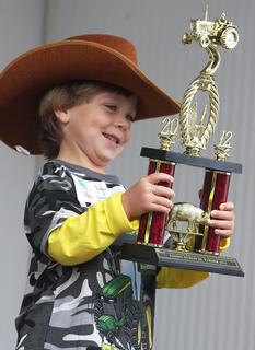 Keegan McKay Cheser, son of Joey and Millie Cheser, won the Tommy Burress Jr. Farmer contest during the 2012 Marion County Country Ham Days.