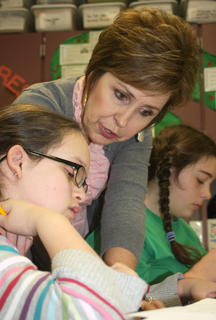Tammy Parman works with Darian Smothers during a lesson using protractors. In the background is Jessah Hughes. Parman was the Marion County Chamber of Commerce's 2012 Outstanding Educator.