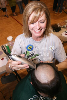 Eileen Hughes had a little fun with Jonathan Livers before cutting off all of his hair. Livers was one of the 105 shavees who raised around $26,000 for the St. Baldrick's Foundation, which provides grants for research to fight children's cancer.