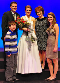 Mattingly poses for a photo with her family after winning the competition Saturday evening. From left, clockwise, is her brother, Kelly, her father, Joe, her mother, Carol and her sister, Nicole. To purchase photos to go: www.carpe-imago.smugmug.com.