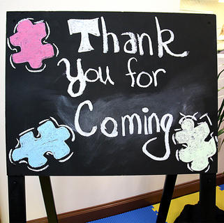 A sign in the autism center thanks visitors for coming.