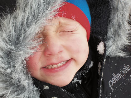 Three-year-old Madax Webb closes his eyes and grins (or grimaces, we can't tell) while playing in the snow recently. His parents are Adam and Tiffany Webb.
