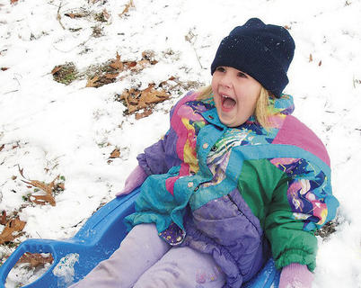 Sarah Grace Orberson, 4, of Gravel Switch is having a blast sledding at her home in Gravel Switch. She is the daughter of Steve and Rhonda Orberson.