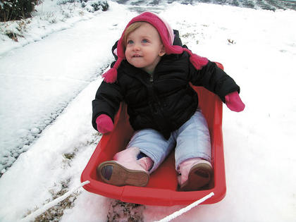Olivia Spalding enjoys her first sledding experience. She is the daughter of Scott and Lauren Spalding of Lebanon.