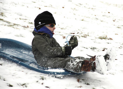 Trey Murphy races down a hill on his sled.