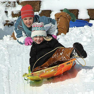 Reiss Anderson enjoys some sledding with the help of her mother, Nikki Anderson. Photo submitted by Tammy Medley.
