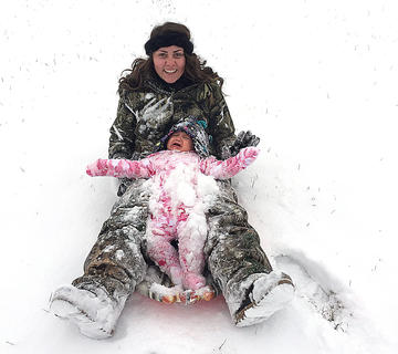 Ten-month-old Idalynn Workman was not a fan of the snow or her first sledding experience. She's pictured with her 16-year-old cousin Haley Workman. Photo submitted by Misty Dougherty.