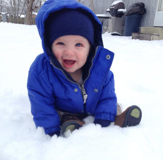 Pictured is seven-month-old Kayden Brady enjoying his very first big snow. Photo submitted by Kendall Brady.