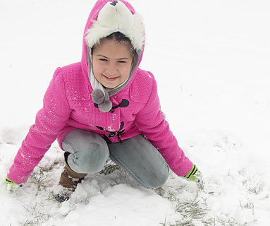 Nora Mitchell draws a heart in the snow. Photo submitted by Lisha Mitchell.