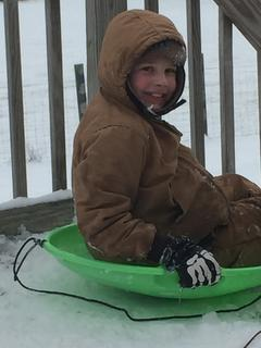 Ty Barker enjoys his first snow day. Photo submitted by Lori Barker.