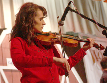 Melanie Belfiore plays the fiddle during Friday evening's show.