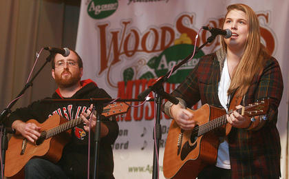 """Michael Bradshaw accompanies Allison Stafford as No Deceit performs """"The River,"""" a song Stafford wrote that won this year's singer/songwriter competition."""