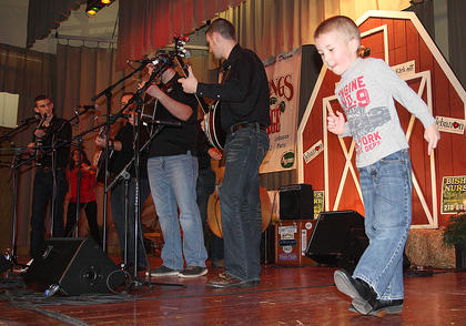 Luke Mattingly, 5, captures the attention of the audience when he got on stage to dance during as Flat Lick Express plays Friday evening.