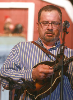 Scott Powers picks the mandolin with the Dale Ann Bradley Band on Saturday.