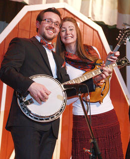 Husband and wife Paul Harrigill and Kelsi Robertson Harrigill, pose for a photo during Flatt Lonesome's performance Friday evening at the Roby Dome.